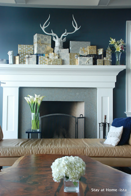 Easy holiday decor with wrapped gifts on a mantle