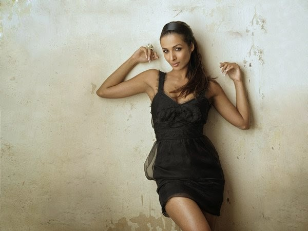 Malaika Arora Khan in black mini skirt thighs show legs show hot pics