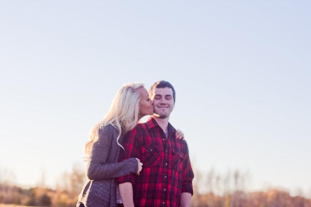 girl kissing her boyfriend on the cheek
