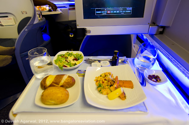 Breads, salads and shrimp and salmon appetiser on Air Canada