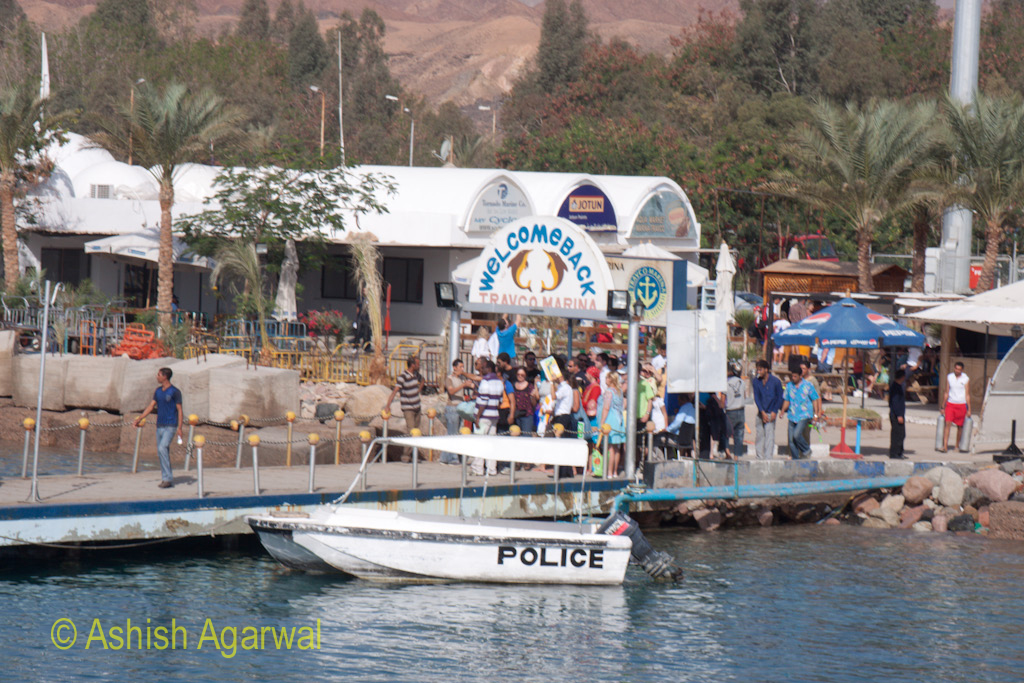 Police boat near a number of tourists at the pier in Sharm el Sheikh in Egypt