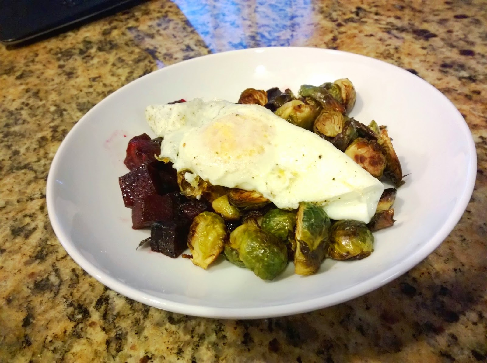 roasted beets and brussels sprouts with a fried egg