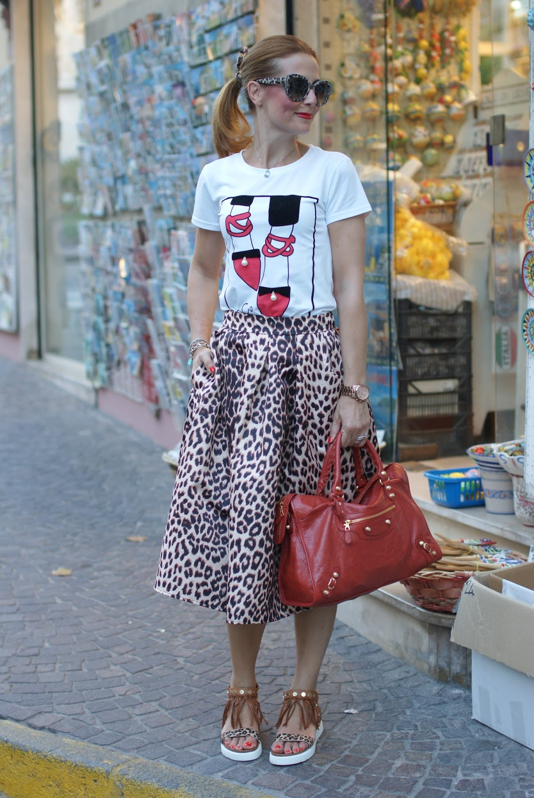 Leopard print is the new neutral with Dolce & Gabbana sunglasses found on Giarre.com, leopard print midi skirt on Fashion and Cookies fashion blog, fashion blogger style