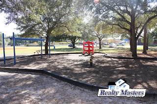 Monkey bars & playground equipment at Tippin Park, Pensacola, FL