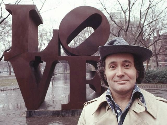 Robert Indiana poses in his sculptures , exhibited in the park. 1971
