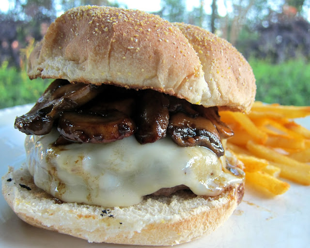 Mushroom Swiss Burgers Recipe -  hamburgers topped with swiss cheese and delicious sautéed mushrooms. One of the best burgers we've had!