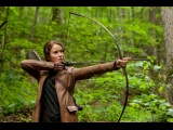 Katniss shoots an arrow in Hunger Games.