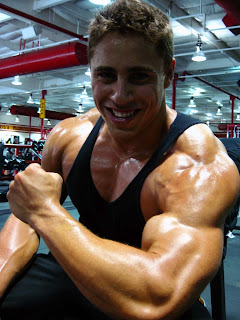 Charley Motreuil arms, big biceps, big round delts