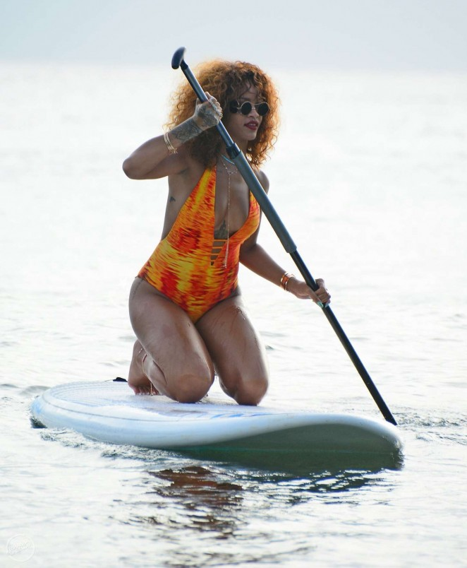 Rihanna Wears Flame-Coloured Swimsuit While Paddleboarding in Barbados