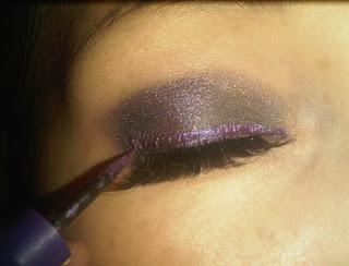 purple eyeliner along the eyelid