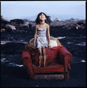 Child girl at Smokey Mountain, the main rubbish site of Manila, Philippines