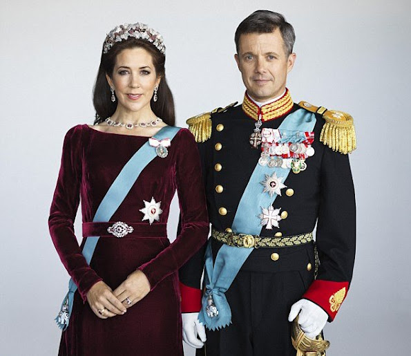 Re-styled glamour: To refresh her look, Mary (with Prince Frederik) accessorised the dress with different earrings and a necklace and wore the Order of the Elephant on a blue sash across her body