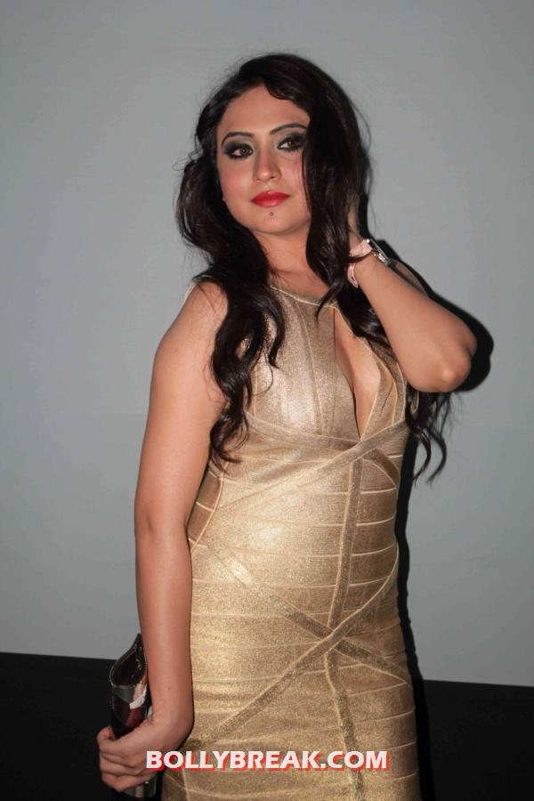 Priya patel posing in a sizzling golden dress and looking steaming hot - Priya Patel golden dress photos