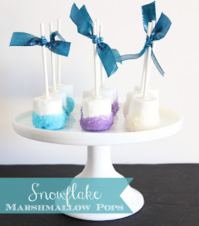 Nice Snowflake Marshmallow Pops for your Frozen Party.