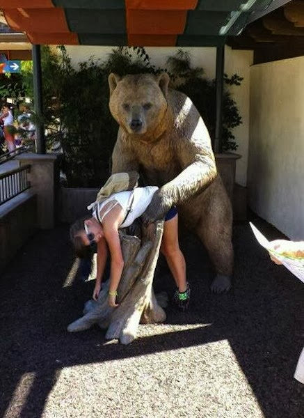 Tourist Posing Inappropriately with Statues