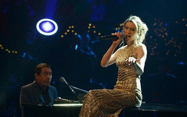 You know the only answer is Joss Stone as she could rocking all the attention of New Year's Eve party on Jools Holland's 2014 Hootenanny TV show.  The 27-year-old might leaved us by stupendous, but that dress is No Joke!. . . . . . . . .She's definitely looked beauty in a gold gown during her music performance at New York, USA on Wednesday, December 31, 2014.