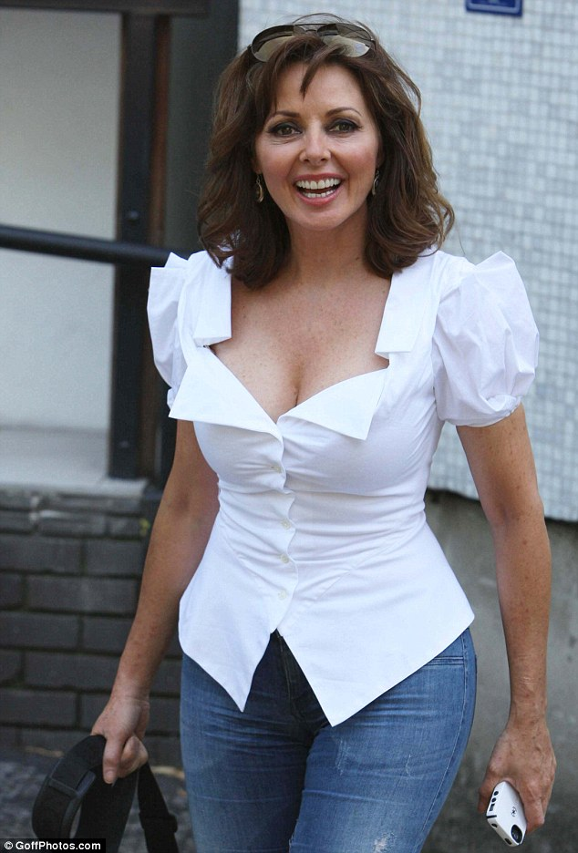 Confident Lady Vorderman Left The Studios Wearing A Low Cut White Shirt That Highlighted Her Bust