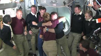 Atlantis – STS135 – Farewell ceremony, Final hug before the crew returns to Atlantis. NASA-TV 2011.