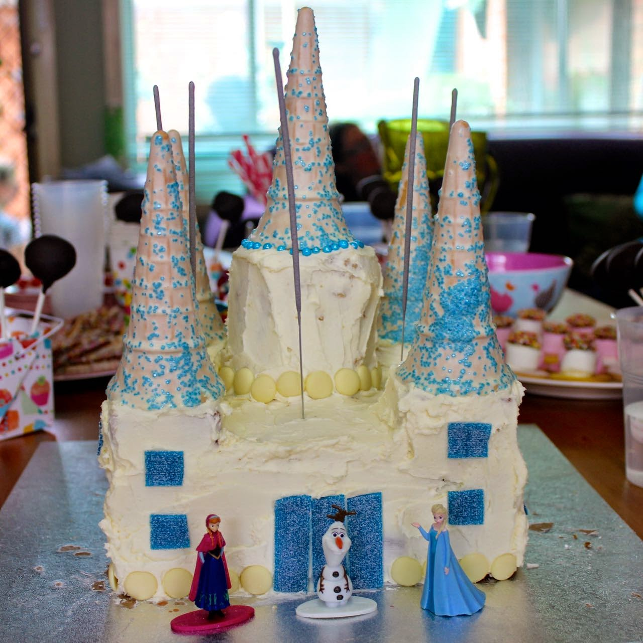 Green Gourmet Giraffe Frozen Castle Birthday Cake step by step
