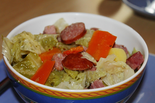 Bowl of Sausage and Cabbage Stew with Carrots