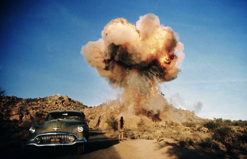 masters of photography : Danny Lyon : photo of car and girl looking bomb explosion
