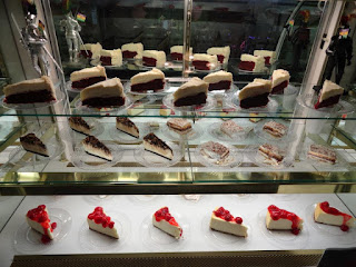 Desserts such as cheesecake with cherries, Red velvet cake and mudpies.