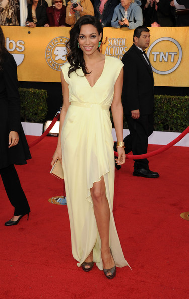 Rosario Dawsonin in a pale citrus-colored (lemon) J. Mendel wrap gown with a simple v-neck, a pale beaded belt accentuating her waist and featuring an asymmetrical hem showing off her legs and her metallic peep-toe Louboutins at the 17th Annual Screen Actors Guild Awards held at The Shrine Auditorium on January 30, 2011 in Los Angeles, California.