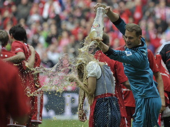 Blonde girl gets beer dousing by Manuel Neuer