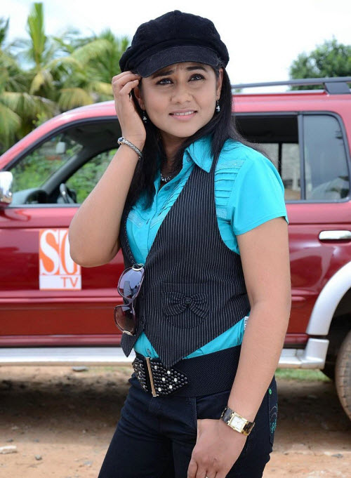 punnagai poo gheetha in jeans - first female producer of films, rj from malaysia