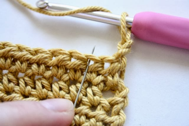 Skip the first stitch and work into the second stitch of the row