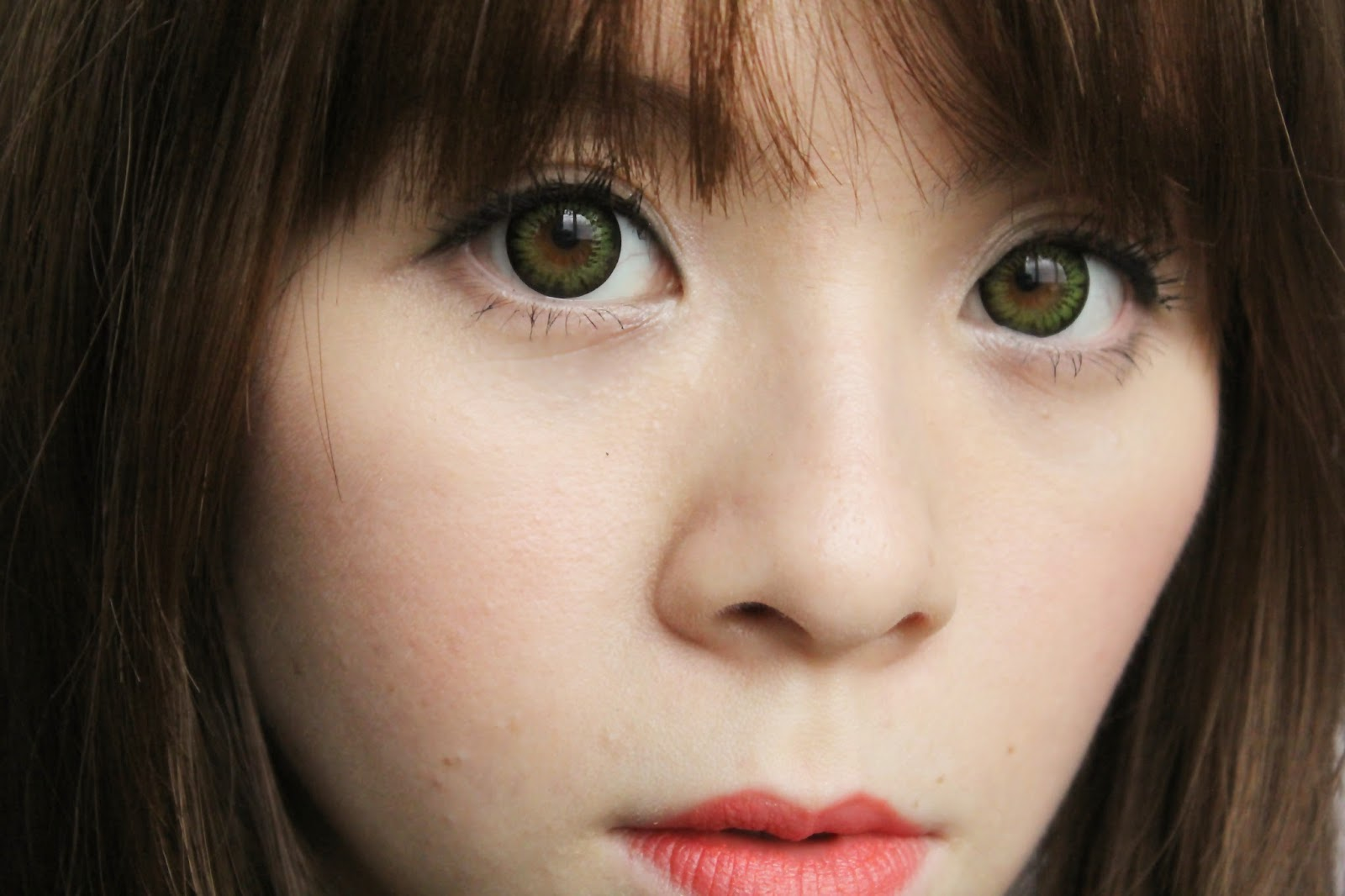 Girl with green contact lens