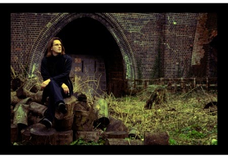 Musician Steven Wilson looking nostalgic in his English hometown train tracks