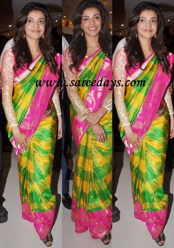 Latest saree designs kajal agarwal in designer green saree checkout kajal agarwal in designer green saree with yellow checked work and pink border with zari work and paired with full sleeves designer blouse with altavistaventures Images