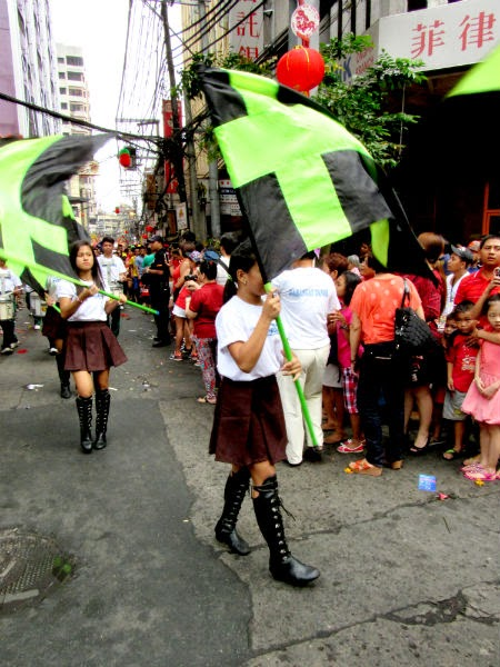 CHINATOWN: Girls twirl their flags during a parade