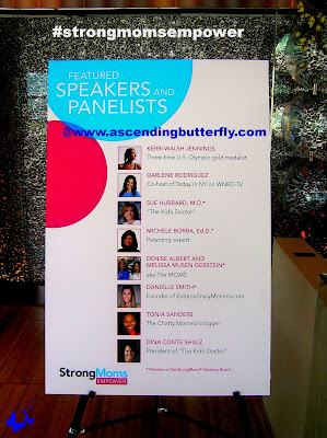 speakers and panelists display signage at strongmoms empowerment summit in New York City, StrongMoms Pledge, The MOMS, Empowerment