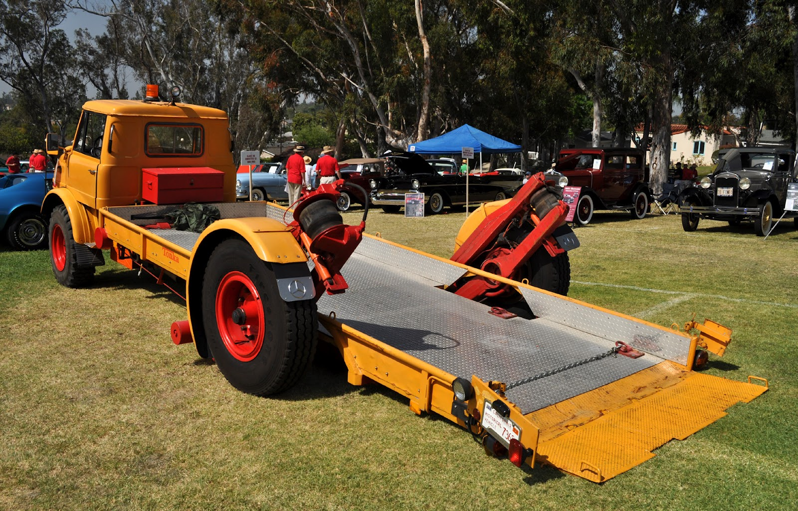 1966 unimog flatbed tow truck with an innovative tilt rear wheel assembly that is brilliant