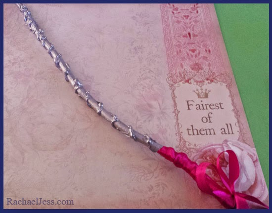 Silver painted wand with red ribbon handle
