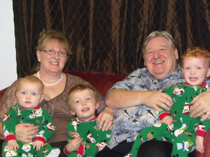BRIAN AND GILLY WITH THREE OF THEIR THIRTEEN GRANDCHILDREN