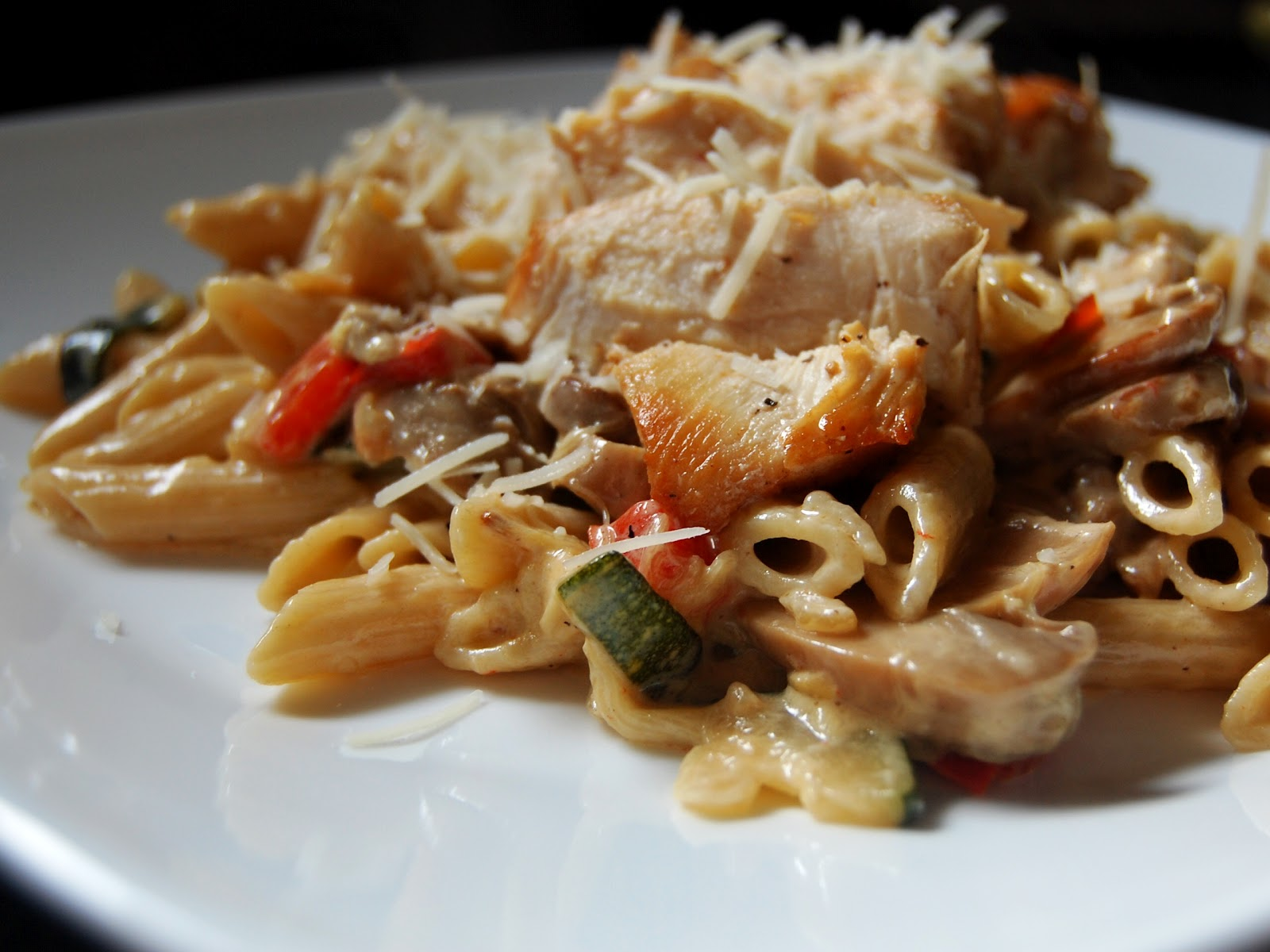 linguine with chicken and vegetables in a cream sauce