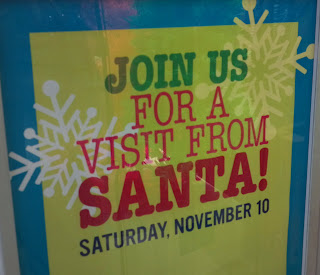 sign that says join us for a visit from santa on november 10