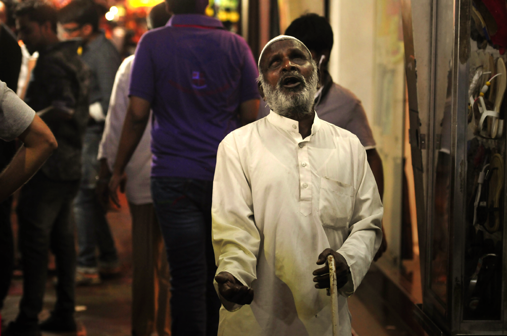 A blind man is begging in the Apollo Bandar area of Bombay in India.