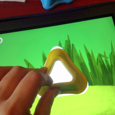 http://www.difflearn.com/product/Tiggly_Shapes/learning_games/?a=toysaretools/