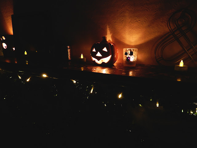 Halloween decorations on a mantelpiece