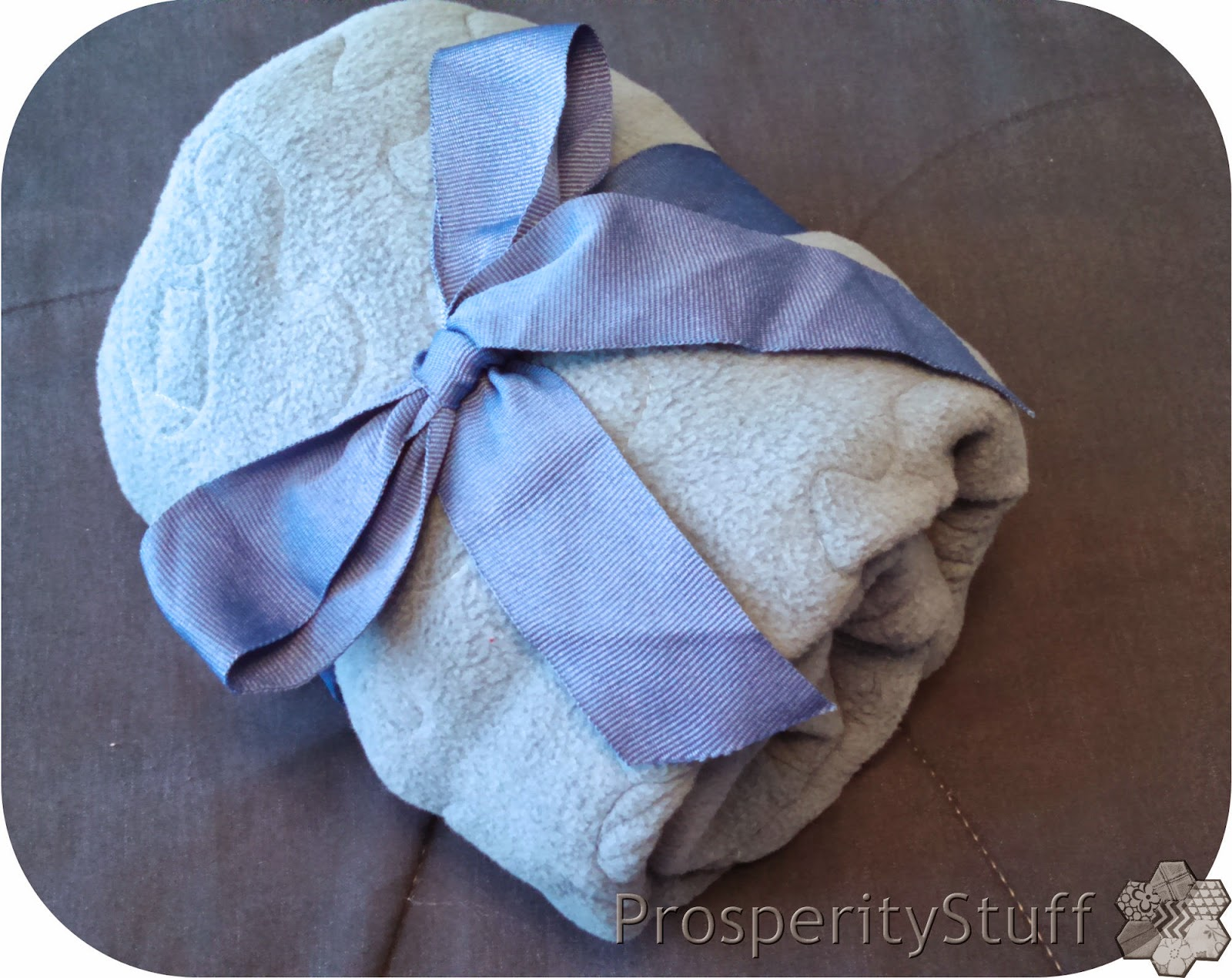 ProsperityStuff Quilts: Fleece and T-Shirt baby quilt wrapped in ribbon