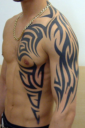 mens tribal tattoos. tribal tattoo dragon.