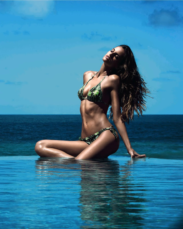 Izabel Goulart posing in a hot two piece bikini with the blue ocean in the background