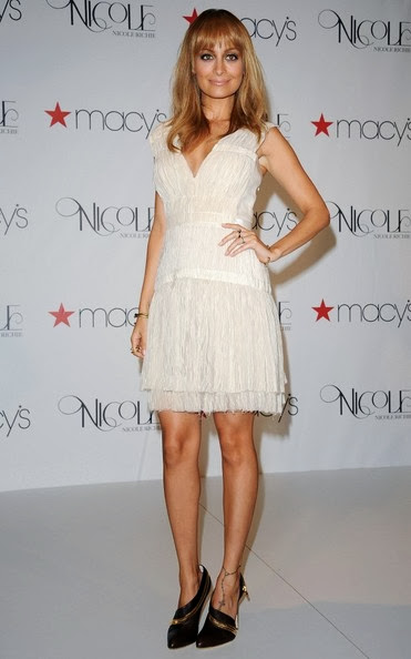 Nicole's white V-neck dress