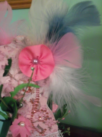 Ribbon and Feather flower of back of dress form
