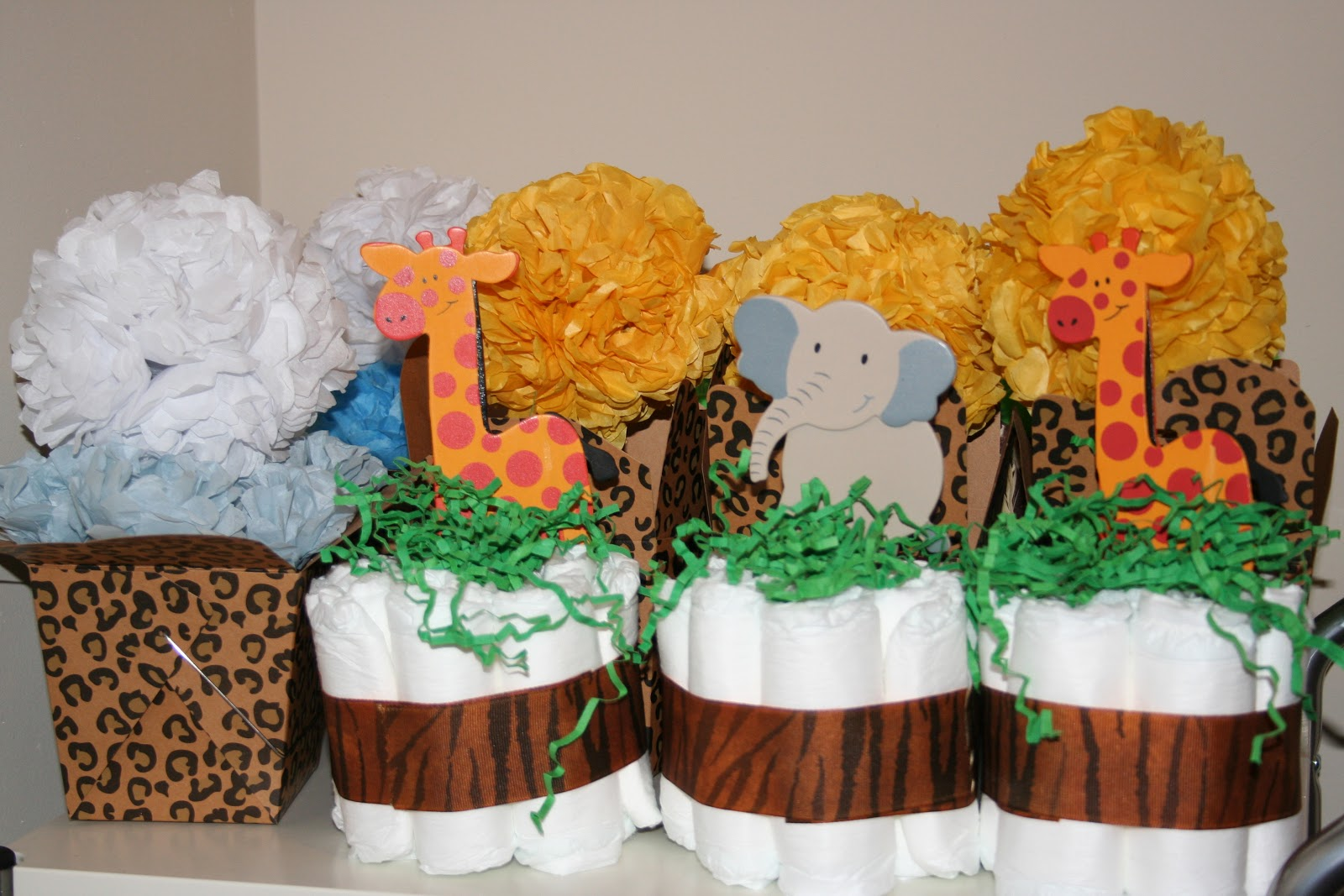 diaper cakes and stuffed safari take out boxes