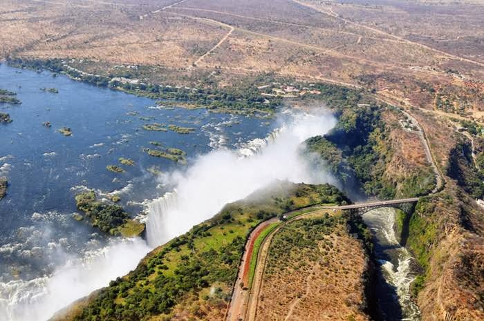 Victoria Falls or Mosi-oa-Tunya is a waterfall in southern Africa on the Zambezi River at the border of Zambia and Zimbabwe.